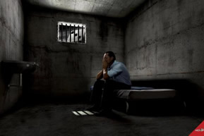 Man sitting in a barred jail cell alone