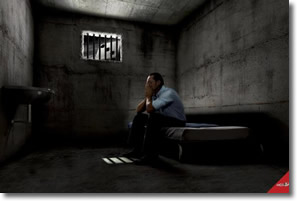Man sitting alone in a jail cell