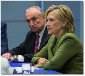Hillary in green