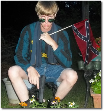 Dylann Roof of Charleston pictured holding both a Confederate flag and a gun