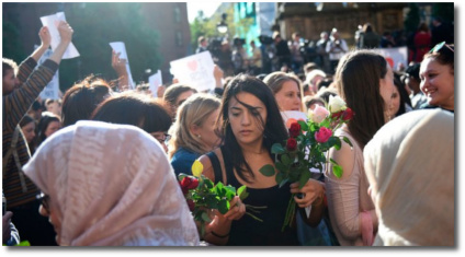 Handing out flowers in Albert Square in Manchester May 23, 2017