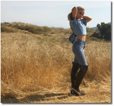 Dove Cameron cowgirl in the tall grass