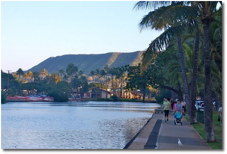 Sidewalk along Ala Wai blvd and Ala Wai canal in Waikiki with Diamond Head in background