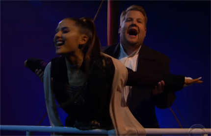 Ariana and James as Rose and Jack singing on the bow of the Titanic